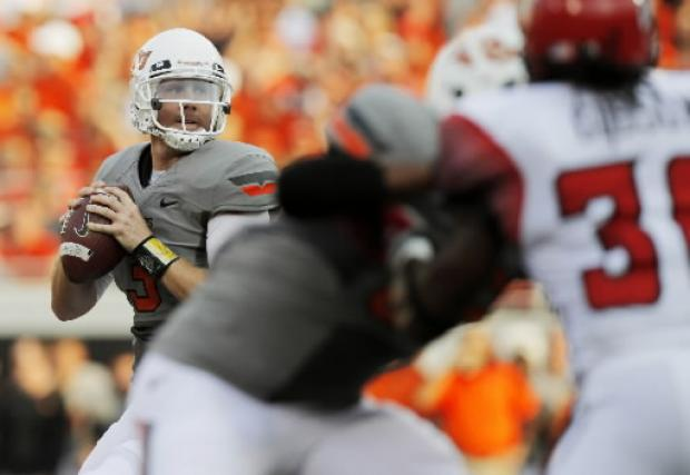 Oklahoma State's Brandon Weeden turns heads, turns 28