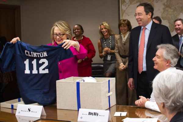 Sec. Clinton with her new 112 jersey--representing the countries visitied during her four-year term.