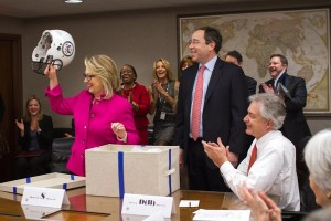 Sec. Clinton is issued a new football helmet to provide additional head protection.