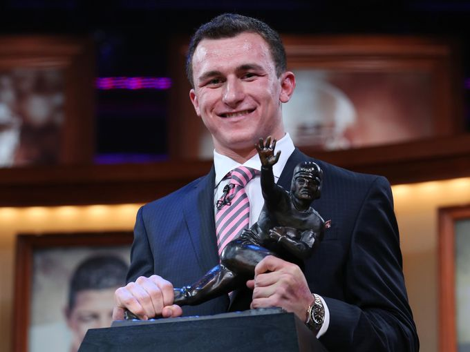 Johnny Manziel with the Heisman Trophy.